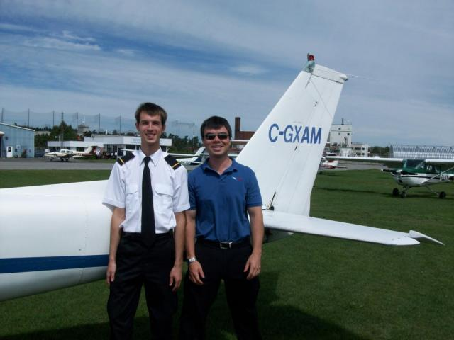 Alexey Dudkin and Instructor Jeff Davey: After the flight Instructor and student pilot pose in front of Cessna 150 trainer..