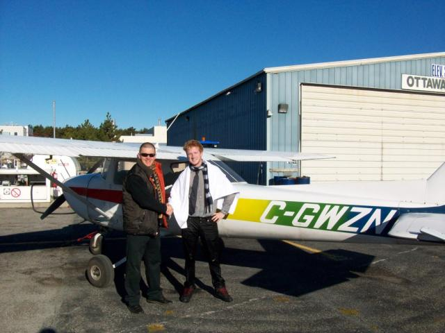 Jamie Scafe after his First Solo: Jamie having already been ceremoniously soaked stands with his instructor Kristian