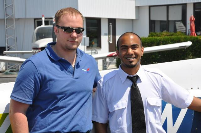 Sarang Radhakrishnan with Instructor Tyler Robinson after Sarang's first solo flight.
