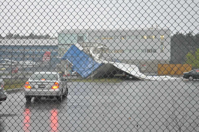 Hangar damage following a wind storm.