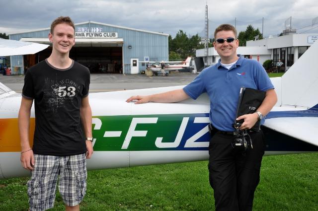 Heros: Patrick and instructor Chris Busch after Patrick's first solo.