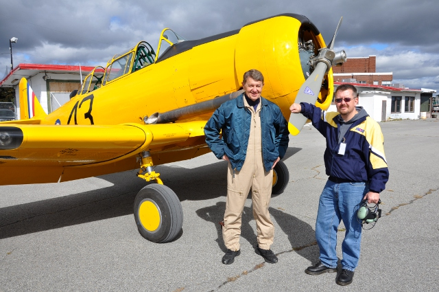 Heros: John Aitken and Aaron Nichols after their flight in the Vintage Wings Harvard.
