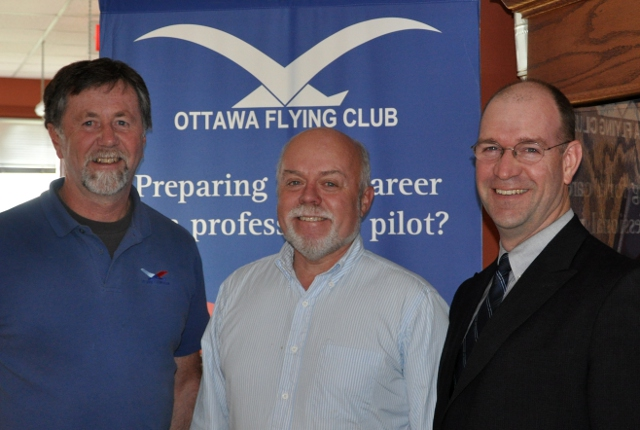 Peter Campbell becomes an Instructor: Peter, centre, with John Porter, CFI, and Mike Mckay the CEO after Peter received his Instructor Rating.