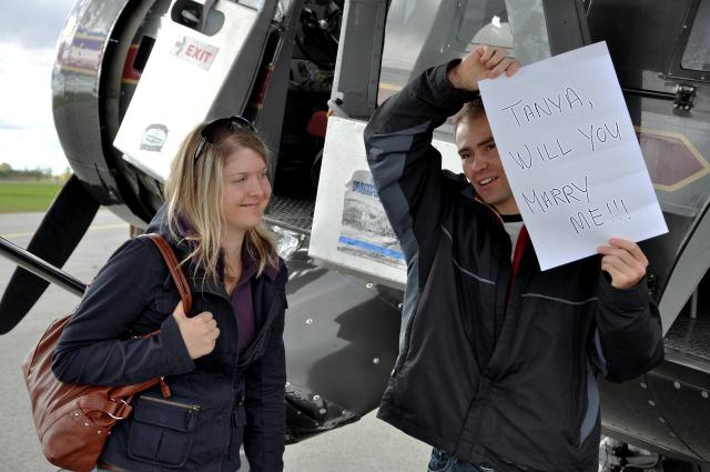 She Said Yes!: Chris shows off the sign he made to propose to Tayna during their flight.  Tayna said yes.
